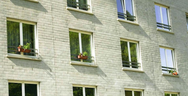 Clean residential windows on brick building